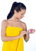 Teen girl with nail buffer — Stock Photo
