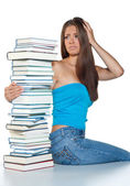 Worried woman with books — Stock Photo