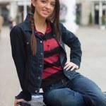 Girl in the street smiling — Stock Photo #24467447