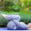 Mature woman in yoga position - Stock Photo