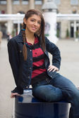 Girl in the street smiling — Stock Photo