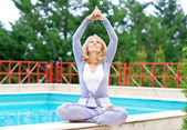 Mature woman in yoga position — Photo