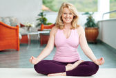 Mature woman in yoga position — Foto Stock