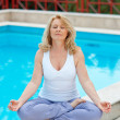 Mature woman in yoga position — Stock Photo #24531203
