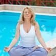 Stock Photo: Mature woman in yoga position