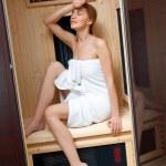 Woman in compact sauna — Stock Photo #25383175