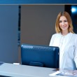 Attractive woman receptionist — Stock Photo #25383297
