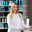 Woman in reception desk — Stock Photo #25384325