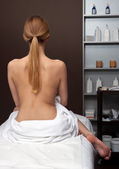 Attractive woman from back on massage table — Stock Photo