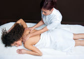 Woman having back adjustment — Stock Photo