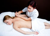 Woman having chiropractic back adjustment — Stock Photo