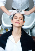 Attractive woman washing her hair — Stock Photo