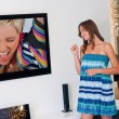 Teen girl in front of tv — Stock Photo #25390289