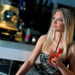 Attractive blond woman in bar — Stock fotografie