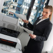 Business woman next to office printer — Stock Photo