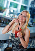 Attractive girl with cocktail — Stock Photo
