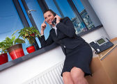 Business woman with phone — Stock Photo