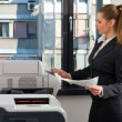 Stockfoto: Business woman working on printer