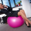 Woman in office on pilates ball — Stock Photo