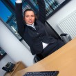 Business woman stretching — Stock Photo #25400751
