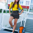 Teen girl in front of school — Stock Photo