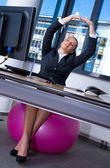 Woman stretching in office — Foto Stock