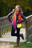 Elegant woman in autumn scenery — Stock Photo
