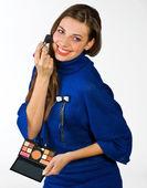 Teen girl putting make up — Stock Photo