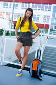 Teen girl in front of school — Stock Photo