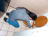 Woman throwing up in the toilet — Stock Photo