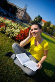 Girl with book in the park — Stock Photo