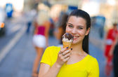 Woman with ice cream in the street — Stock Photo