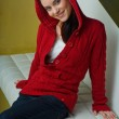 Girl in red clothes smiling — Stock Photo #26011483