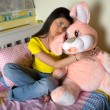 Girl with big bunny toy — Stock Photo