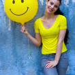Teen girl with smiley balloon — Stock Photo