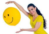 Teen girl with smiley balloon — Stock Photo