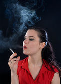 Young woman with cigarette — Stock Photo