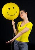 Woman with smiley balloon — Stock Photo