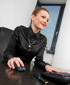 Businesswoman at desk — Stock Photo