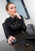 Businesswoman at desk — Stock Photo