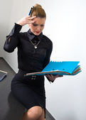 Stressed businesswoman with documents — Stock Photo