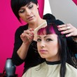 Hair stylist making cool haircut — Stock Photo