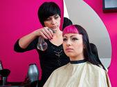 Hair stylist making cool haircut — Stock Photo
