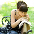 Sad girl with book — Foto de Stock