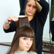 Hair stylist with hair blower — Stock Photo