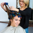 Hair stylist in work — Stock Photo