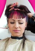 Emo looking teen girl in hair salon — Stock Photo