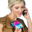 Woman with credit cards and mobile phone — Stock Photo #26311987