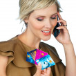 Woman with credit cards and mobile phone — Stock Photo