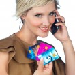 Woman with credit card and mobile phone — Stock Photo